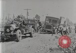 Image of Fire Truck pulls a Firestone tire truck out of ditch United Kingdom, 1920, second 2 stock footage video 65675025337