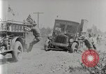 Image of Fire Truck pulls a Firestone tire truck out of ditch United Kingdom, 1920, second 7 stock footage video 65675025337
