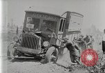 Image of Fire Truck pulls a Firestone tire truck out of ditch United Kingdom, 1920, second 10 stock footage video 65675025337