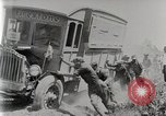 Image of Fire Truck pulls a Firestone tire truck out of ditch United Kingdom, 1920, second 11 stock footage video 65675025337