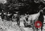 Image of Men and machines building a concrete highway United States, 1920, second 2 stock footage video 65675025339