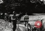 Image of Men and machines building a concrete highway United States USA, 1920, second 4 stock footage video 65675025339