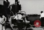 Image of Men and machines building a concrete highway United States USA, 1920, second 11 stock footage video 65675025339
