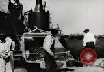 Image of Men and machines building a concrete highway United States USA, 1920, second 12 stock footage video 65675025339
