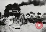 Image of Men and machines building a concrete highway United States, 1920, second 17 stock footage video 65675025339