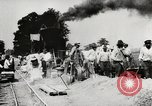 Image of Men and machines building a concrete highway United States, 1920, second 18 stock footage video 65675025339