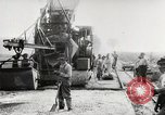 Image of Men and machines building a concrete highway United States, 1920, second 19 stock footage video 65675025339