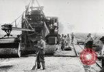 Image of Men and machines building a concrete highway United States, 1920, second 20 stock footage video 65675025339