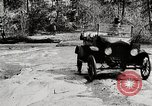 Image of Ford Model T cars driving in water, snow, & along railroad tracks United States USA, 1922, second 4 stock footage video 65675025341