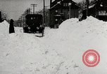 Image of Ford Model T cars driving in water, snow, & along railroad tracks United States USA, 1922, second 5 stock footage video 65675025341