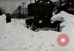 Image of Ford Model T cars driving in water, snow, & along railroad tracks United States USA, 1922, second 7 stock footage video 65675025341