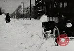 Image of Ford Model T cars driving in water, snow, & along railroad tracks United States USA, 1922, second 8 stock footage video 65675025341
