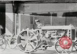 Image of Farmer plowing field with Fordson Tractor United States USA, 1920, second 1 stock footage video 65675025346