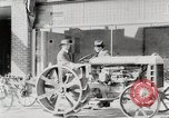 Image of Farmer plowing field with Fordson Tractor United States USA, 1920, second 3 stock footage video 65675025346