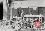 Image of Farmer plowing field with Fordson Tractor United States USA, 1920, second 4 stock footage video 65675025346