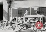 Image of Farmer plowing field with Fordson Tractor United States USA, 1920, second 6 stock footage video 65675025346