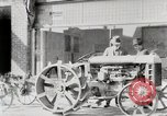 Image of Farmer plowing field with Fordson Tractor United States USA, 1920, second 12 stock footage video 65675025346