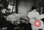 Image of motorized washing machine, vacuum cleaner, and spinning wheel United States USA, 1920, second 2 stock footage video 65675025347