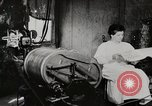Image of motorized washing machine, vacuum cleaner, and spinning wheel United States USA, 1920, second 3 stock footage video 65675025347