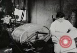 Image of motorized washing machine, vacuum cleaner, and spinning wheel United States USA, 1920, second 4 stock footage video 65675025347