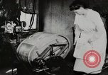 Image of motorized washing machine, vacuum cleaner, and spinning wheel United States USA, 1920, second 5 stock footage video 65675025347