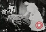 Image of motorized washing machine, vacuum cleaner, and spinning wheel United States USA, 1920, second 6 stock footage video 65675025347
