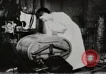 Image of motorized washing machine, vacuum cleaner, and spinning wheel United States USA, 1920, second 7 stock footage video 65675025347