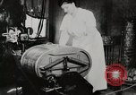 Image of motorized washing machine, vacuum cleaner, and spinning wheel United States USA, 1920, second 8 stock footage video 65675025347