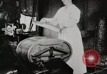 Image of motorized washing machine, vacuum cleaner, and spinning wheel United States USA, 1920, second 9 stock footage video 65675025347