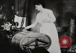 Image of motorized washing machine, vacuum cleaner, and spinning wheel United States USA, 1920, second 10 stock footage video 65675025347