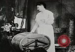 Image of motorized washing machine, vacuum cleaner, and spinning wheel United States USA, 1920, second 11 stock footage video 65675025347
