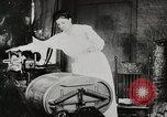 Image of motorized washing machine, vacuum cleaner, and spinning wheel United States USA, 1920, second 12 stock footage video 65675025347