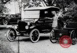 Image of Henry Ford, Edsel Ford, and the 10 millionth Ford Model T car United States USA, 1924, second 2 stock footage video 65675025381