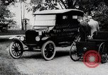 Image of Henry Ford, Edsel Ford, and the 10 millionth Ford Model T car United States USA, 1924, second 3 stock footage video 65675025381