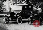 Image of Henry Ford, Edsel Ford, and the 10 millionth Ford Model T car United States USA, 1924, second 4 stock footage video 65675025381