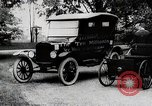 Image of Henry Ford, Edsel Ford, and the 10 millionth Ford Model T car United States USA, 1924, second 5 stock footage video 65675025381