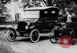 Image of Henry Ford, Edsel Ford, and the 10 millionth Ford Model T car United States USA, 1924, second 6 stock footage video 65675025381