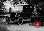 Image of Henry Ford, Edsel Ford, and the 10 millionth Ford Model T car United States USA, 1924, second 7 stock footage video 65675025381