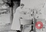 Image of American woman washes United States USA, 1915, second 4 stock footage video 65675025388