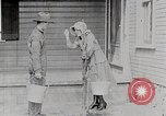 Image of Young woman pumping water United States USA, 1915, second 5 stock footage video 65675025390