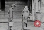 Image of Young woman pumping water United States USA, 1915, second 8 stock footage video 65675025390