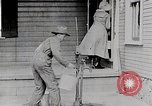 Image of Young woman pumping water United States USA, 1915, second 10 stock footage video 65675025390