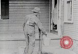 Image of Young woman pumping water United States USA, 1915, second 11 stock footage video 65675025390