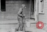 Image of Young woman pumping water United States USA, 1915, second 12 stock footage video 65675025390