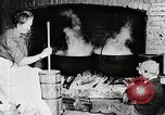 Image of Old American woman churns butter United States USA, 1915, second 2 stock footage video 65675025391