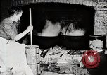 Image of Old American woman churns butter United States USA, 1915, second 7 stock footage video 65675025391