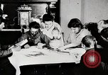 Image of American boys and women read United States USA, 1915, second 4 stock footage video 65675025392
