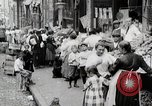 Image of Busy market street United States USA, 1919, second 10 stock footage video 65675025398