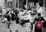 Image of Busy market street United States USA, 1919, second 12 stock footage video 65675025398