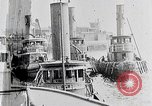 Image of New York Harbor and Brooklyn Bridge seen from steamship New York City USA, 1917, second 2 stock footage video 65675025400